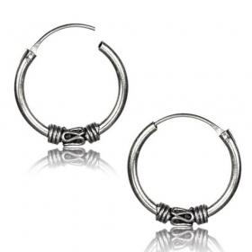 \\\'\\\'Mahaan khodana\\\'\\\' chiseled silver earrings